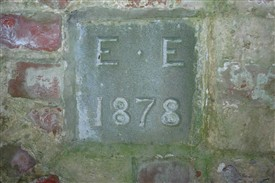 Photo:The date plate in the pump house  (initials 'E.E.' as yet untraced).
