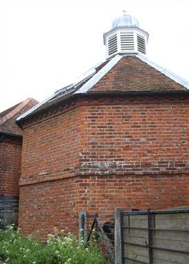 Photo:The rear of the converted dovecote showing the blackened 'burnt header' bricks