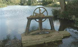 Photo:Godinton Lake (previously called Lady's Lake) with sluice-gate lifting gear. This was used to maintain the level in the lake, so giving adequate pressure to the water driving the pump wheel.